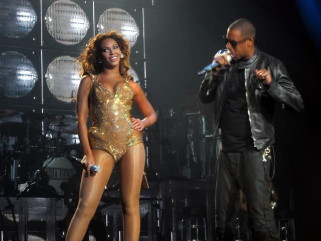 Beyoncé and Jay-Z perform together on stage.