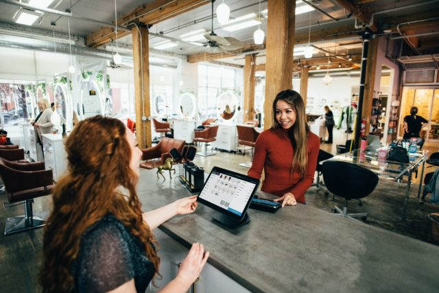Customer and staff interacting in a business setting.